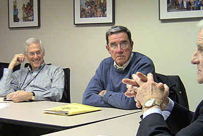 Emeritus faculty talk during a meeting
