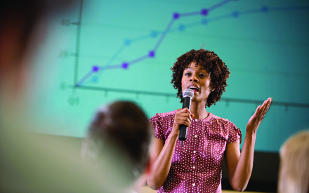 Woman physician presenting research to audience
