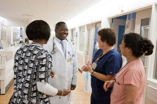 Physician chatting with clinic staff